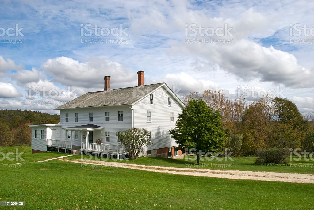 White wooden New England farmhouse stock photo