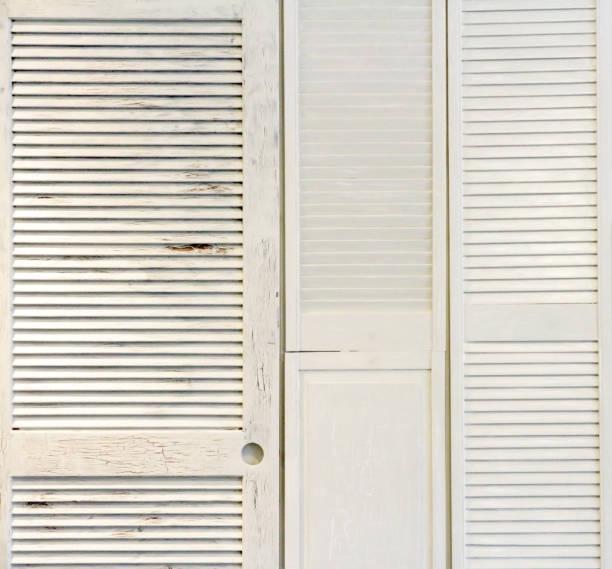 white wooden shutters on the wall - com portada imagens e fotografias de stock