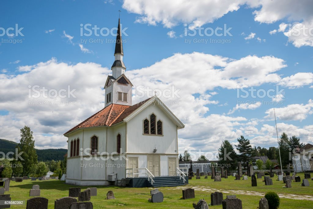 white wooden stave church near Leira in Norway stock photo