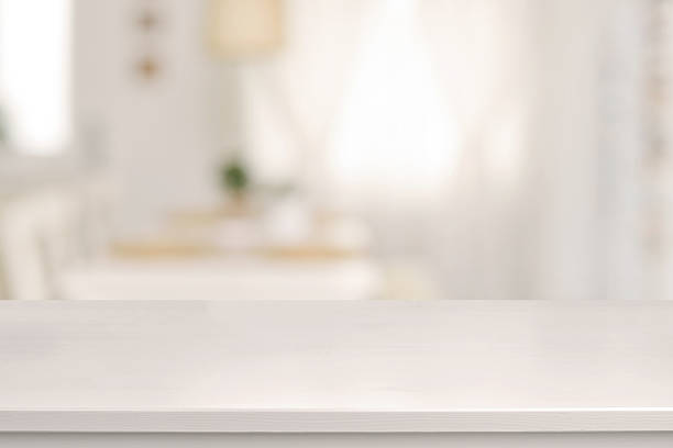 White wooden table and blurred dining room stock photo