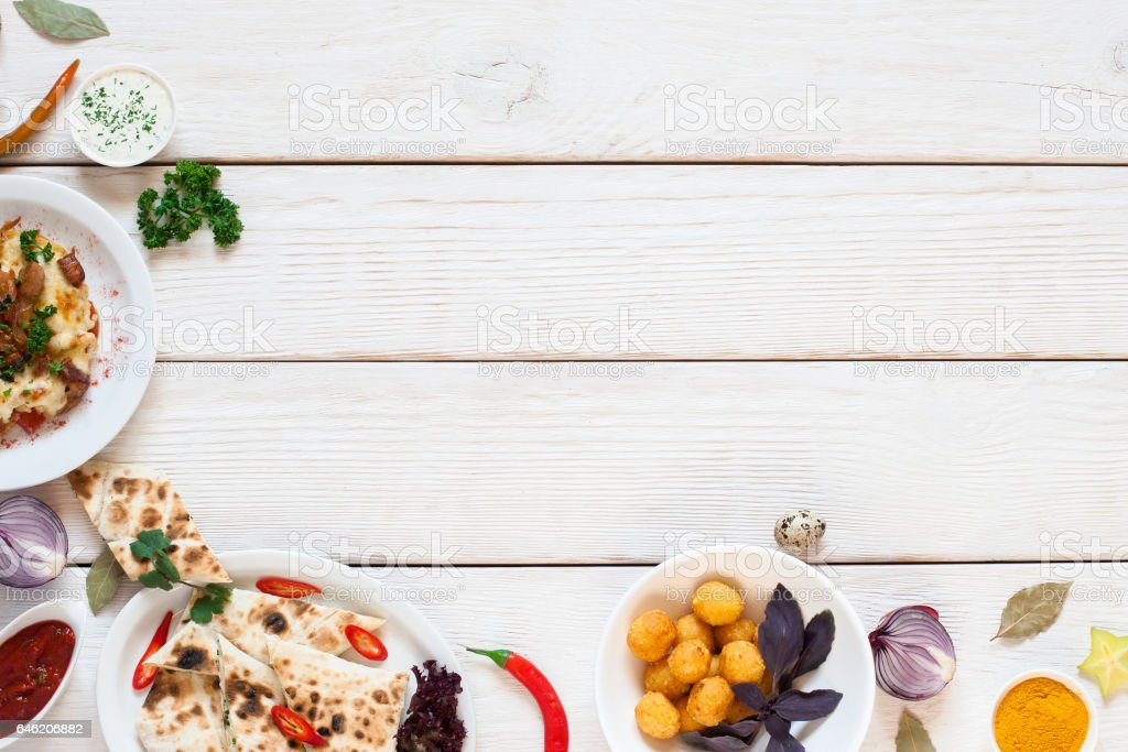 White wooden table with breakfast border flat lay stock photo