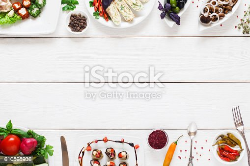 istock White wooden table with traditional food frame 610565936