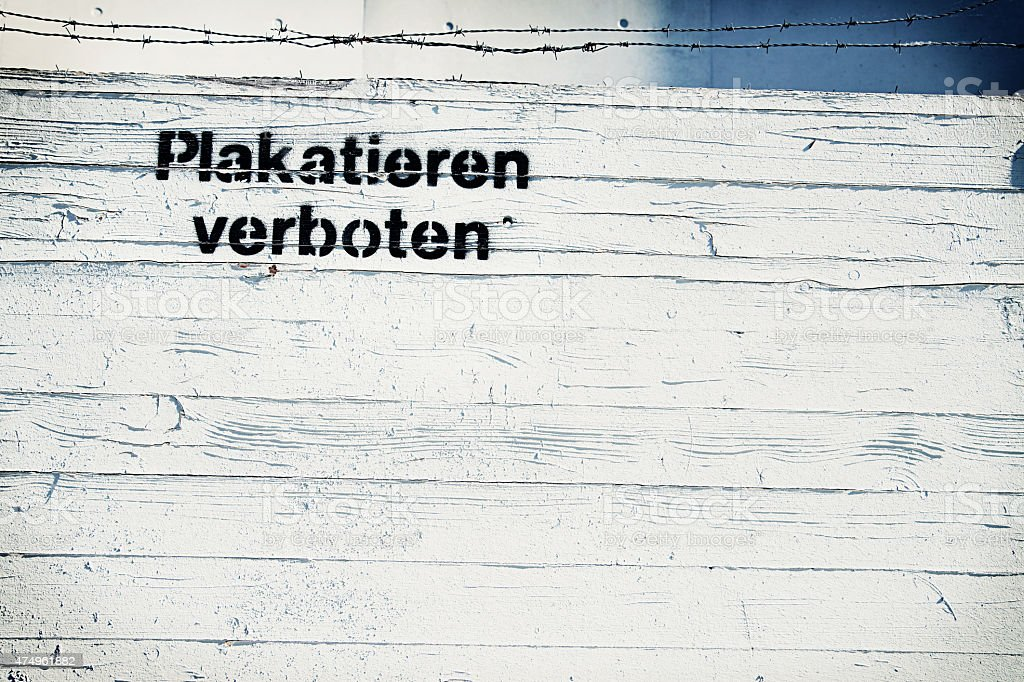 White wooden wall with text 'Plakatieren verboten' stock photo