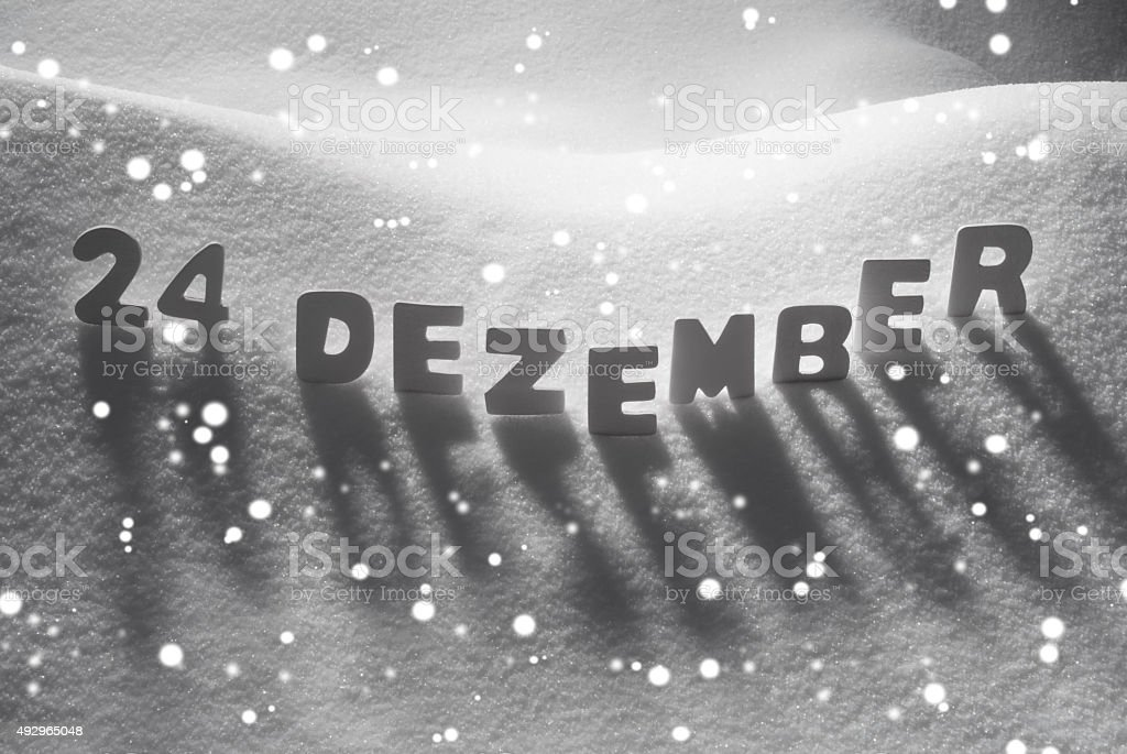 White Word 24 Dezember Means 24th December On Snow, Snowflakes stock photo