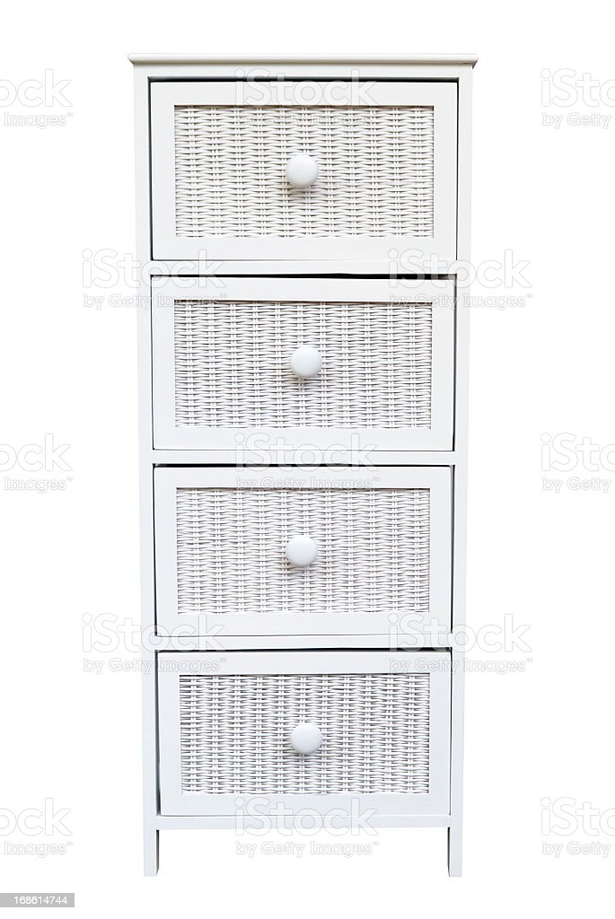 White woven cabinet with drawers isolated on white background stock photo