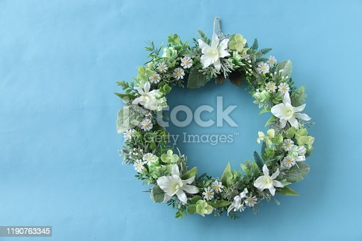 white wreath of orchid and daisy