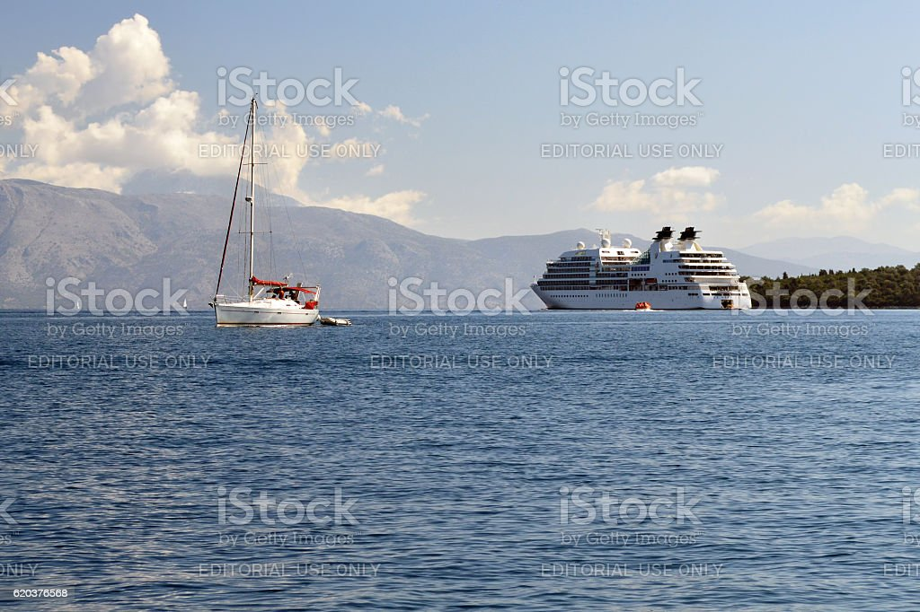 White yacht and big cruise ship in calm sea foto de stock royalty-free