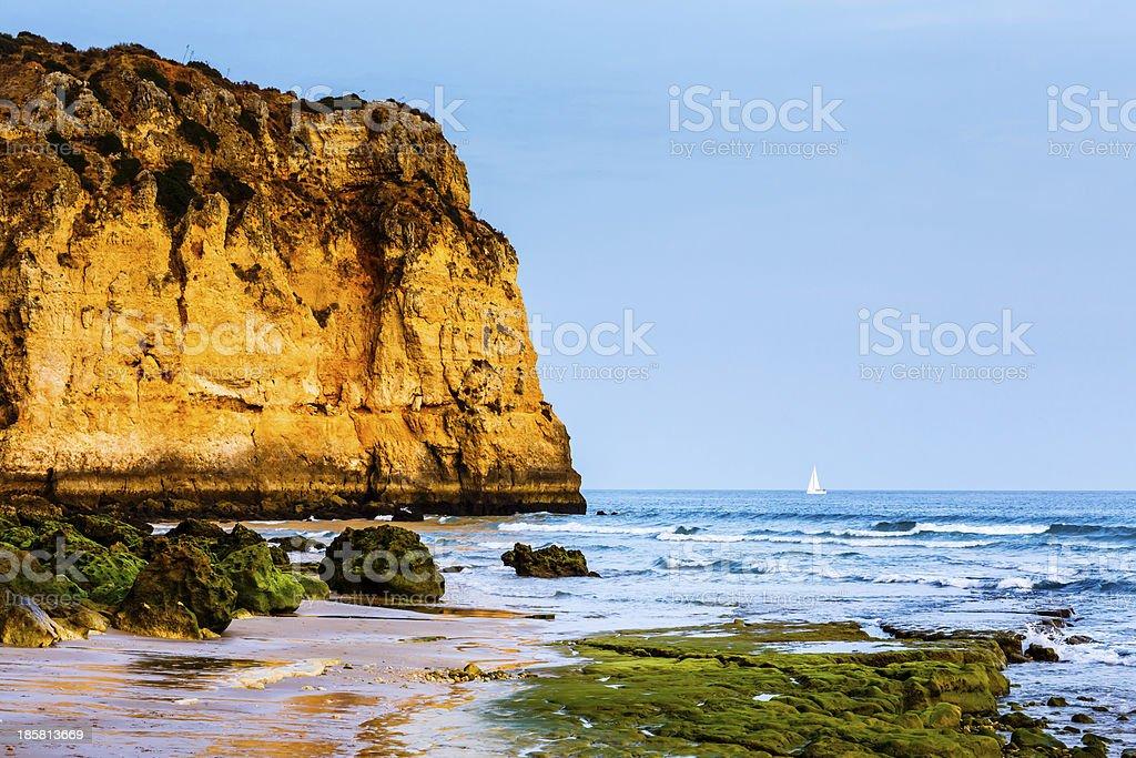White Yacht at Porto de Mos Beach in Lagos, Algarve royalty-free stock photo