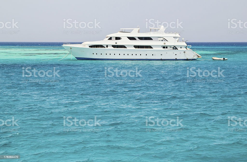 white yacht in blue sea stock photo
