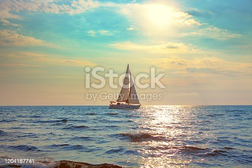 white yacht sailing in the sunlight