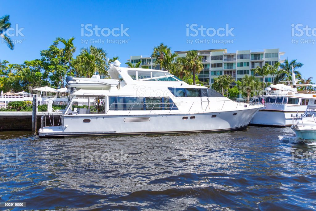 White Yacht Moored in the Intracoastal - Royalty-free Blue Stock Photo