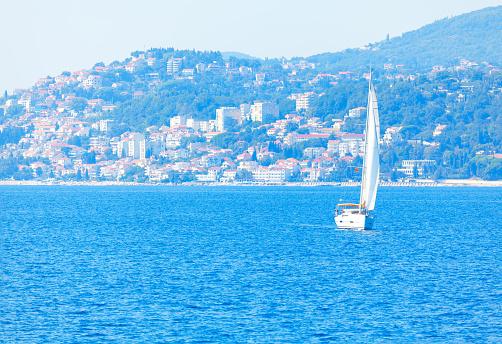 White yacht on the blue bay  . Coastal city background