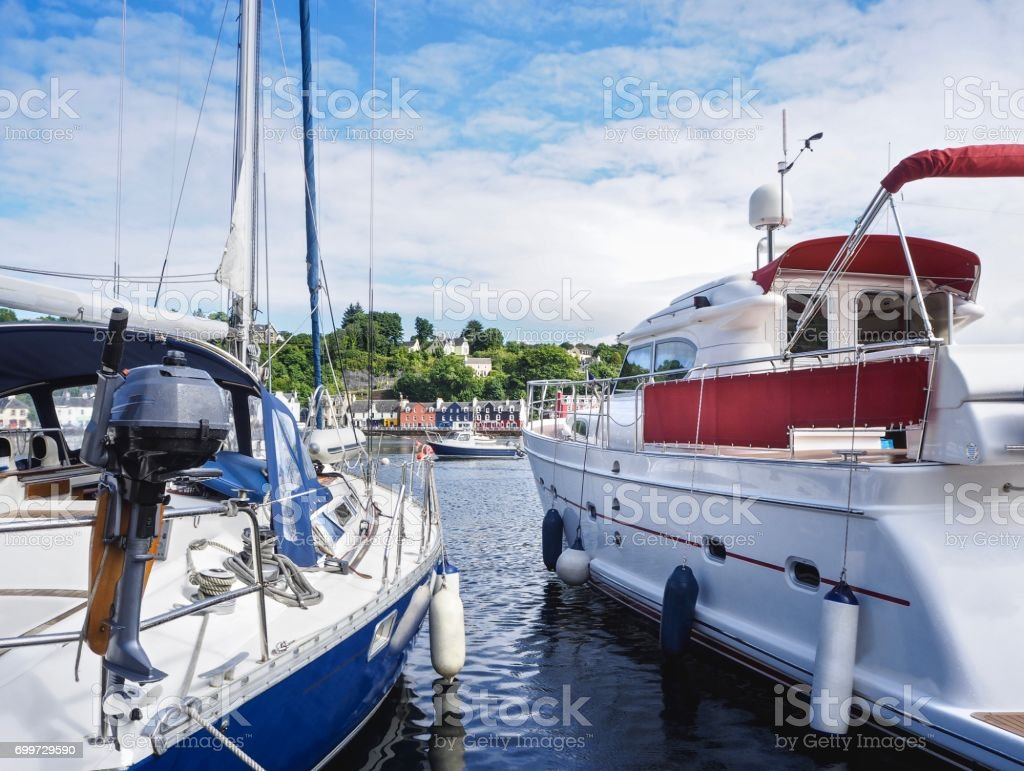 White Yachts  On Tobermory Town Background stock photo