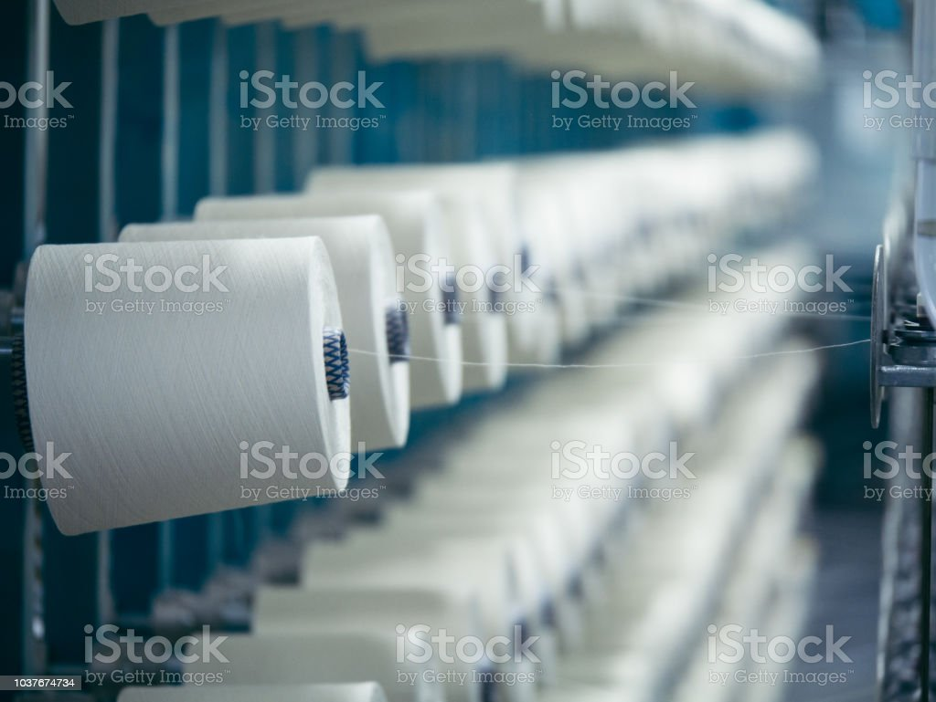 White yarn spools of industrial  warping machine  in textile factory royalty-free stock photo