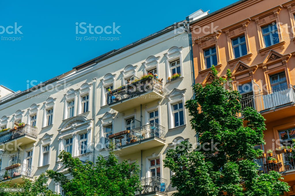 white, yellow and brown facaded buildings in a row stock photo