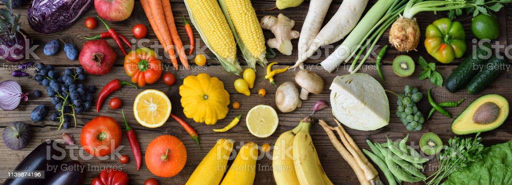 White, yellow, green, orange, red, purple fruits and vegetables on...