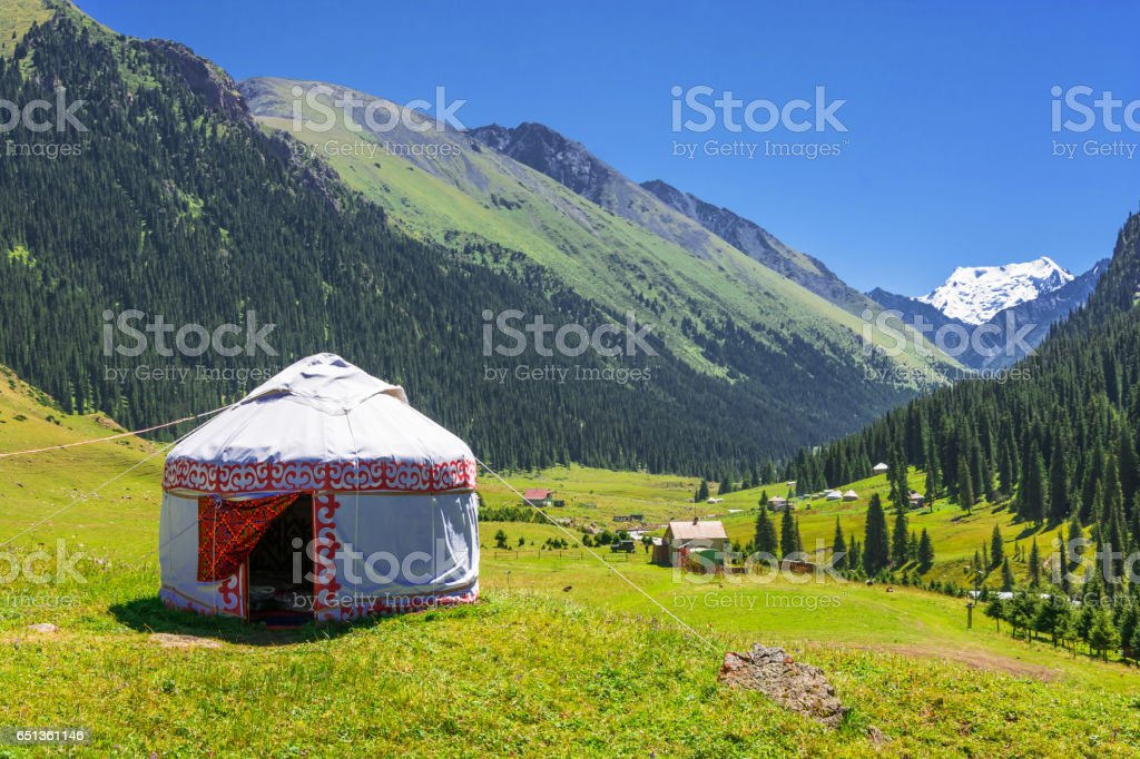 White Yurt in the mountains of Kyrgyzstan. стоковое фото