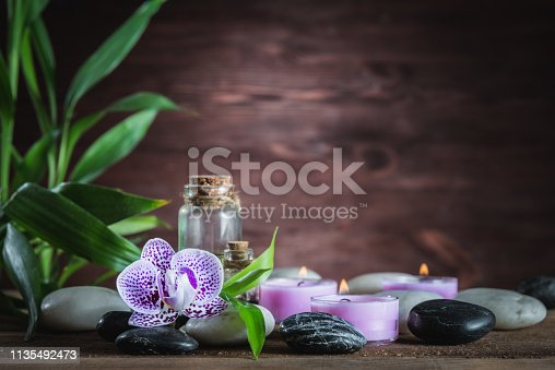 white zen  balance stones,orchid and bamboo plant on the wooden table