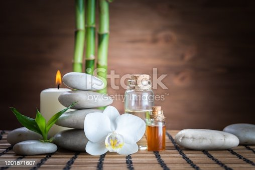 istock white zen  balance stones,orchid and bamboo plant on the wooden table 1201871607