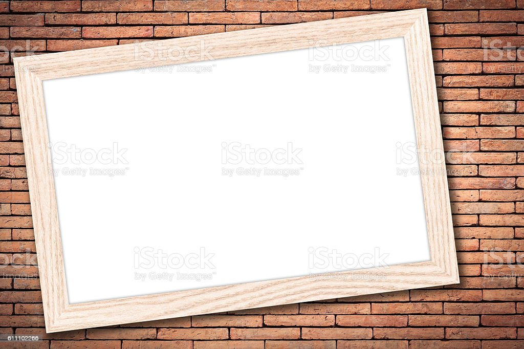 whiteboard with a wooden frame on brick wall background