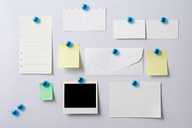 Whiteboard with attached items,Blank Polaroid,Envelope,Adhesive Note,Note Pad stock photo