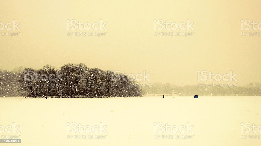 Whiteout Winter Ice Fishing Scene like a Painting stock photo