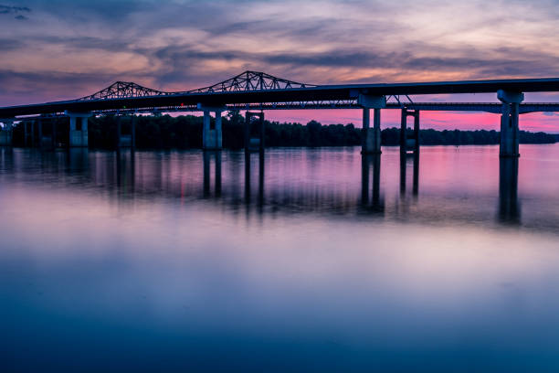 Whitesburg Bridge sunset Sunset at the Whitesburg Bridge crossing the Tennessee River in Huntsville, Alabama. tennessee river stock pictures, royalty-free photos & images