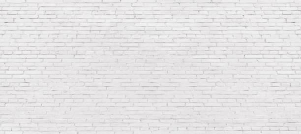 whitewashed brick wall, light brickwork background for design. White masonry stock photo