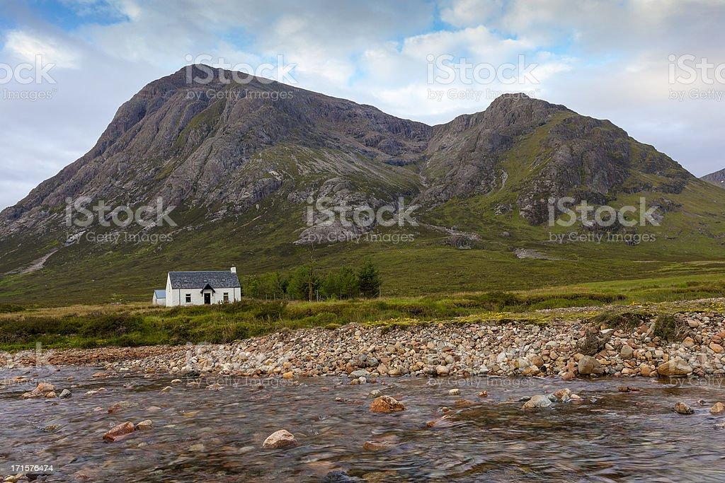 Whitewashed cottage in the Scottish Highlands. stock photo
