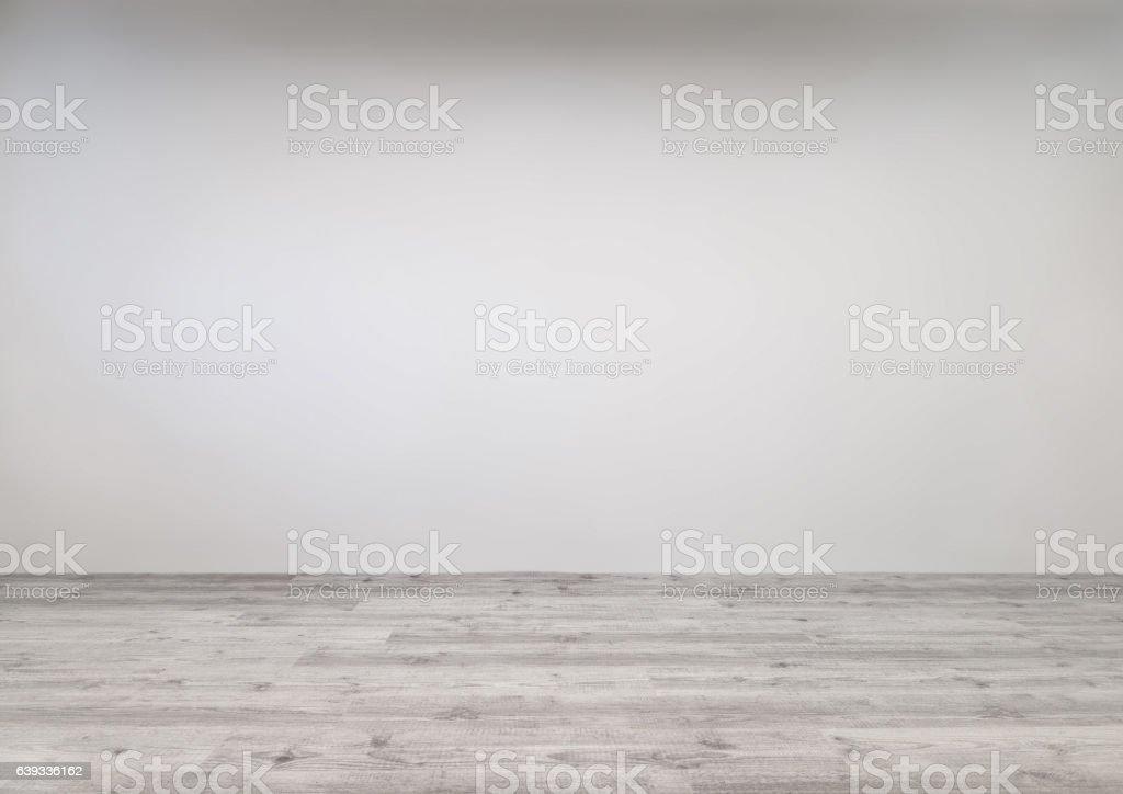 Whitewashed laminate with newly painted wall stock photo