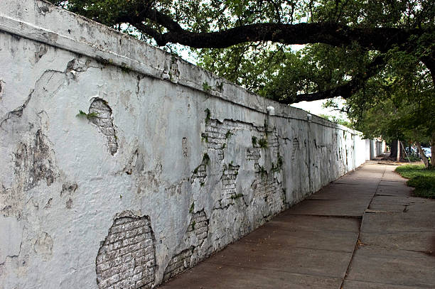Whitewashed Wall around Lafayette Cemetery, Garden District, New Orleans stock photo