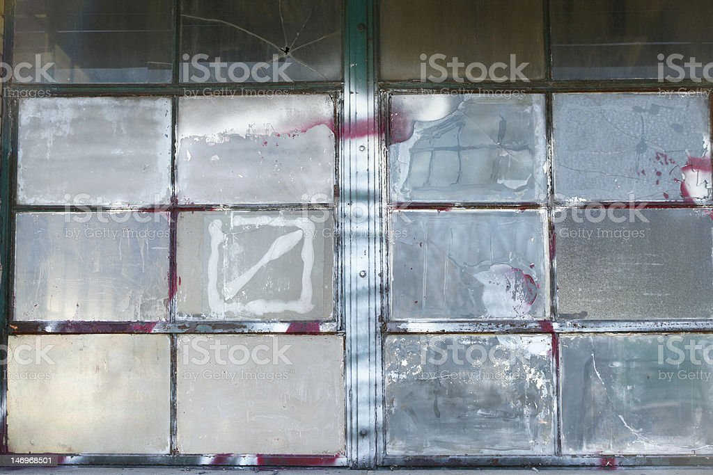 whitewashed warehouse windows from an out of business company royalty-free stock photo