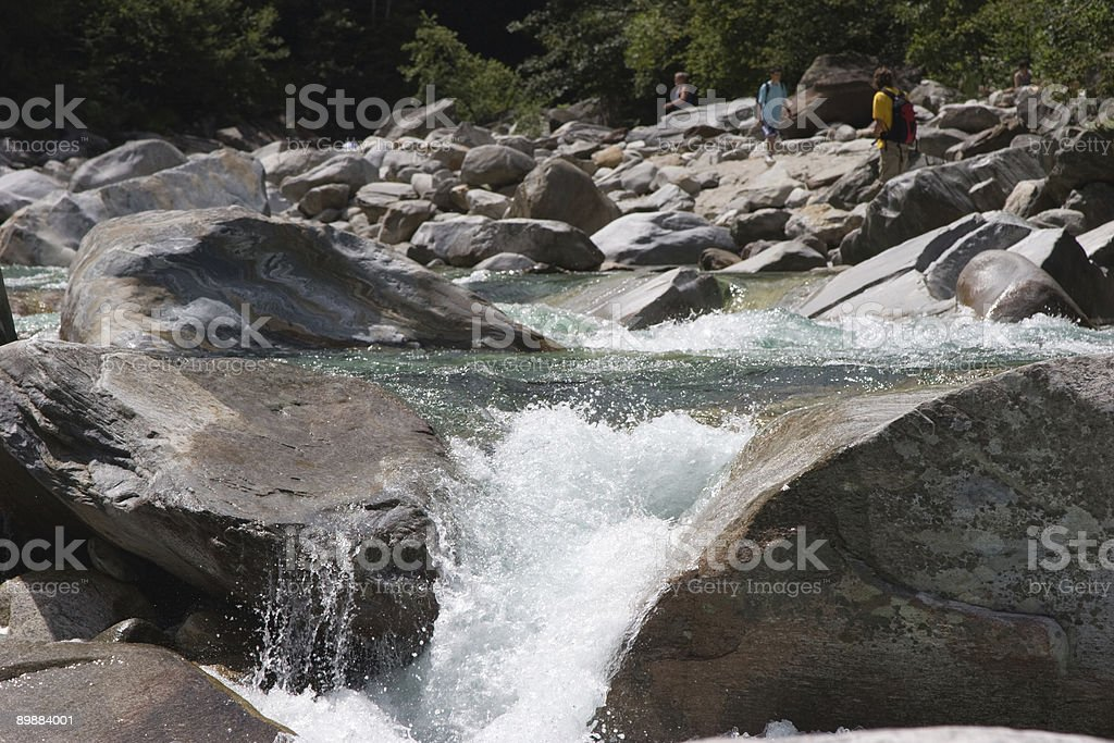 Whitewater and hiking tourists royalty-free stock photo