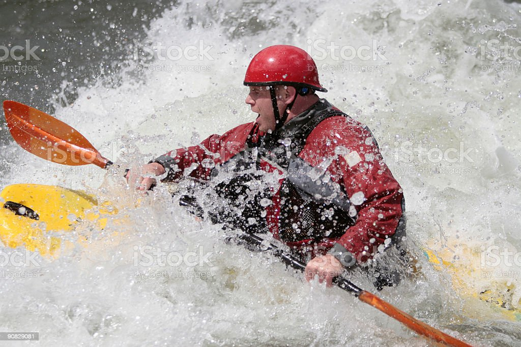 Whitewater Kayaker Paddling Through the Waves royalty-free stock photo