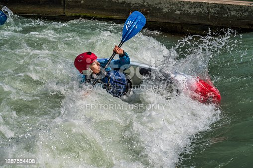 istock Whitewater kayaking training on the Eiskanal in Augsburg, Germany 1287554408