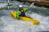 Augsburg, Germany - June 16, 2020: Whitewater kayaking training, extreme kayaking. A guy in a kayak sails on the Eiskanal in Augsburg Germany