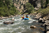 Rafting into a beautiful Colorado canyon in the summertime.http://www.istockphoto.com/file_thumbview_approve.php?size=1&id=4057444