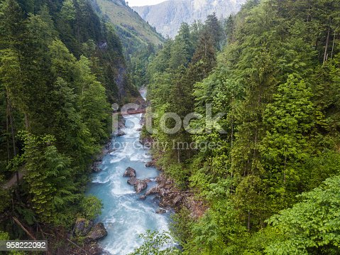 The canyon of the whitewater river Steyr in the Austrian alps. The water is still blue from the melting snow in the montains in springtime. Location: next to the small ski resort Hinterstoder in the
