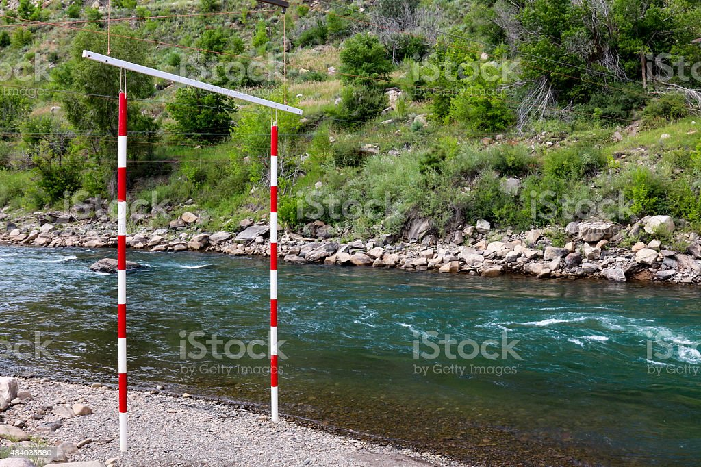 Whitewater slalom gate on the side of the Animas River stock photo