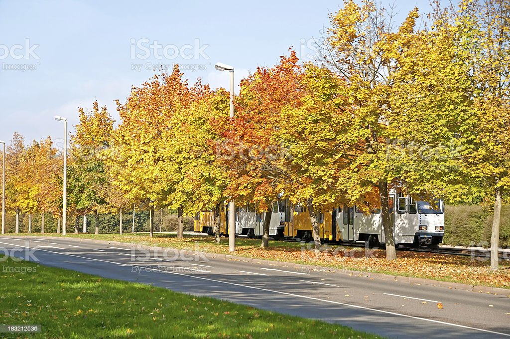 White-yellow tram in autumn, city Gera, Thuringia Germany royalty-free stock photo