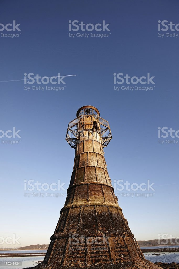 Whitford Lighthouse at low tide royalty-free stock photo