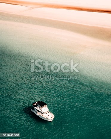 istock whitsunday beach with a boat 831035338