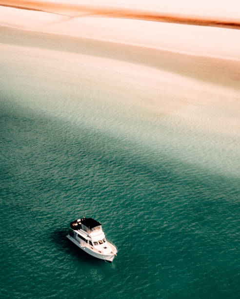 whitsunday beach with a boat stock photo