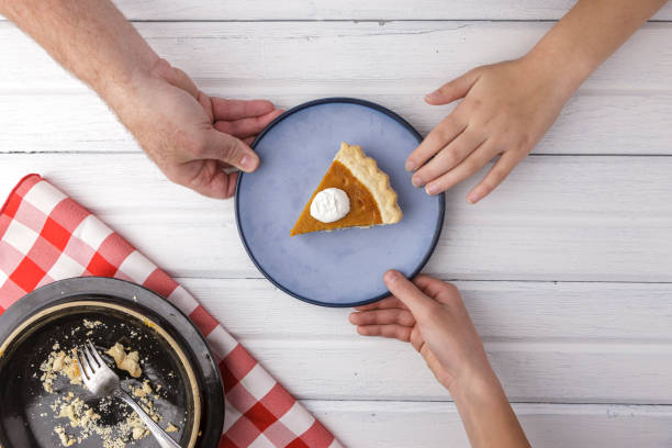 Who gets the last piece of pie? stock photo