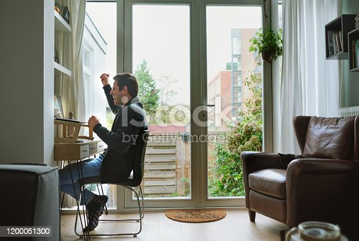 Shot of a young man using a laptop and cheering at home
