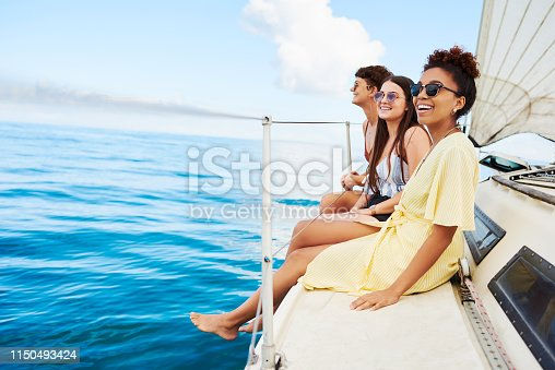 Shot of a group of happy young women enjoying a relaxing day on a yacht