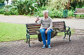Shot of a senior woman taking a selfie on her mobile phone in the park