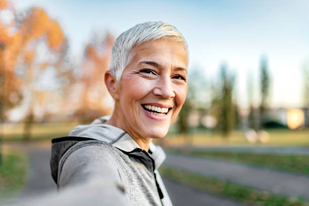 Who said selfies are just for the youth? Close Up Portrait of Happy Cheerful Delightful Charming Beautiful Mature Lady Granny Grandma Taking a Selfie on Vacation. Selfie Portrait of Happy Senior Woman With Short Gray Hair Outdoor. Sporty Senior Woman Taking Selfie in the Park After Workout. 60 64 years stock pictures, royalty-free photos & images