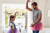 Shot of a father and daughter dancing in their tutus