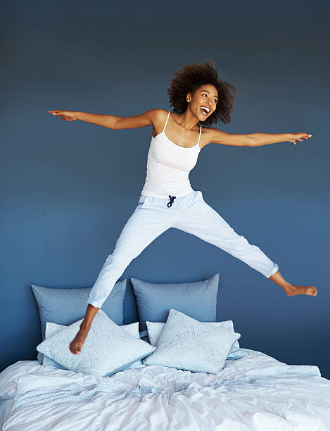 Image result for jumping on bed